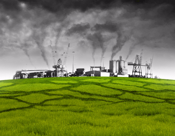 Green field showing a factory with the pollution level.